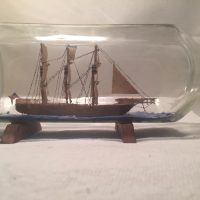 antique folk art ship in a bottle