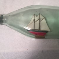 Ketch sailboat in bottle