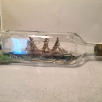 Ship in a triangle bottle from England