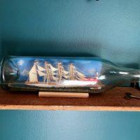 X antique ship in a bottle