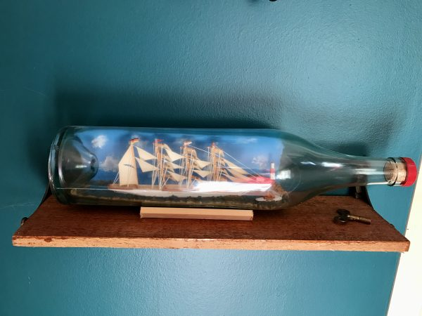 X antique ship in a bottle