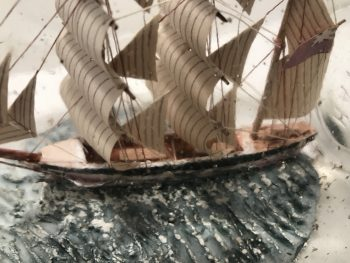 wonderful 3 masted English Frigate, hand carved with deck housing, complex rigging. Hand painted on a blue sea.