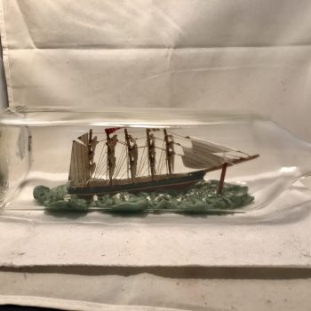 Antique quad masted ship in a bottle from England