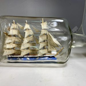 Large fully rigged ship in bottle
